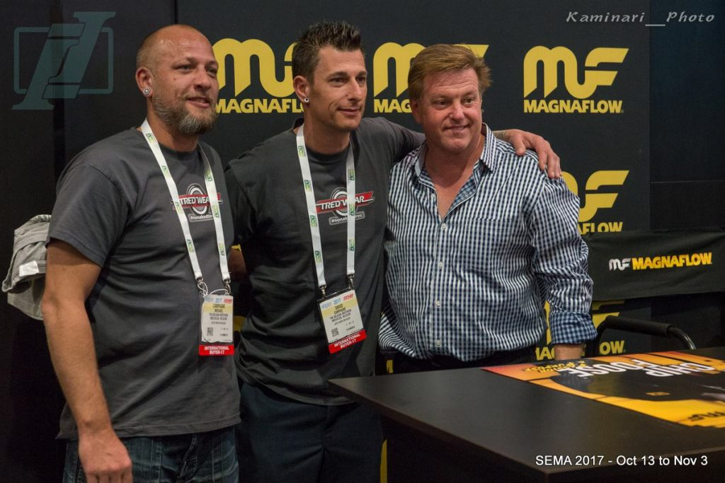 Chip Foose signing autographs and taking photos at the Magnalow Booth
