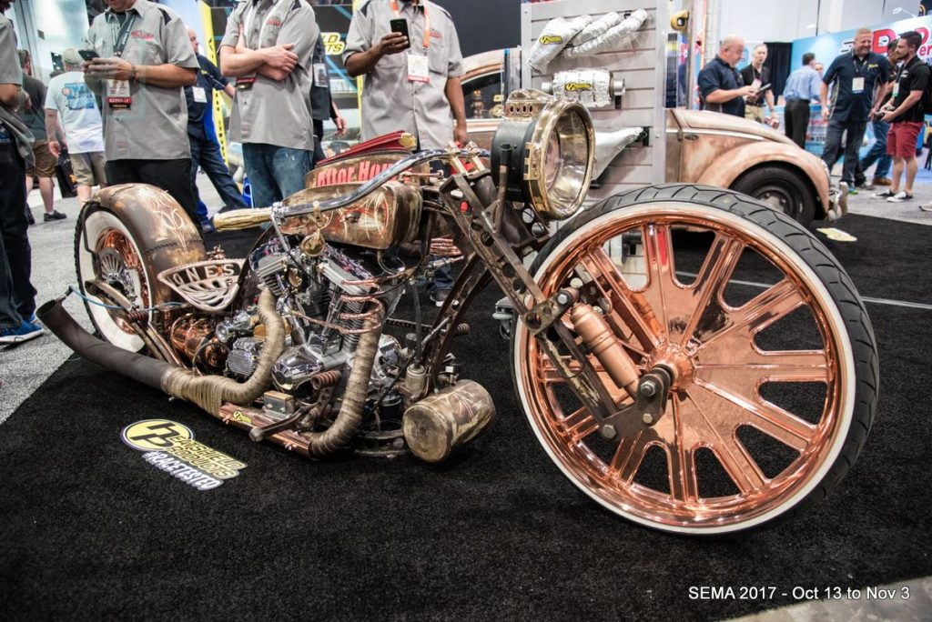 "The ""After Hours"" custom bike and ""Dung Beetle"" (background) on display at the Heatshield Products booth."
